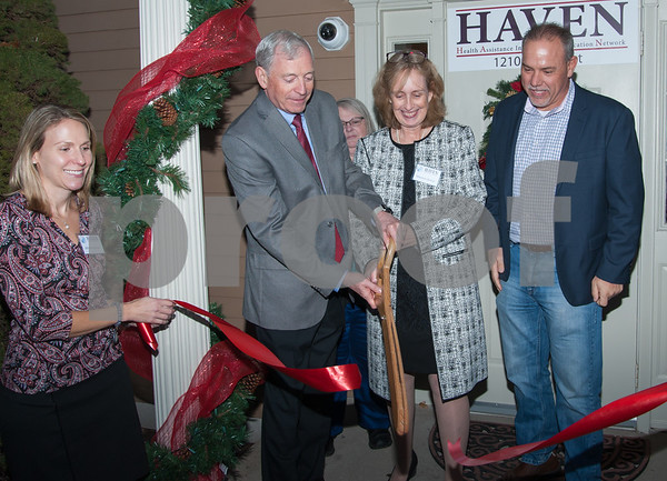 12/07/17 Wesley Bunnell | Staff HAVEN held a ribbon cutting at its new location in Berlin on Thursday afternoon to mark its relocation from Southington. Cutting the ribbon are Dr. Thomas Calnon, Maureen Dinnan, and State Representative Joe Aresimowicz.