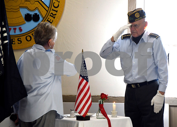 12/7/2017 Mike Orazzi | Staff Shelia Bousquet and Chuck Bouffard performs the POW MIA ceremony during the Pearl Harbor Day ceremony at Bristol American Legion Thursday morning.