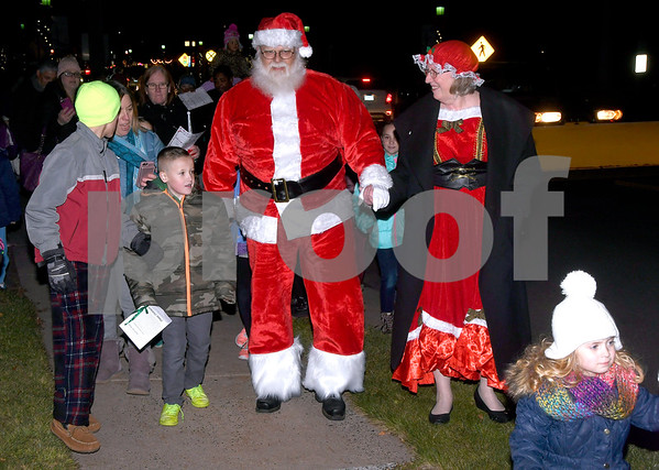 12/8/2017 Mike Orazzi | Staff Santa and Mrs Claus arrive on a fire truck during the annual tree lighting held at the Plainville Fire Department Friday evening.