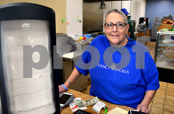 12/8/2017 Mike Orazzi | Staff Fancy Bagels' Jackie Gualtieri in Southington Friday.