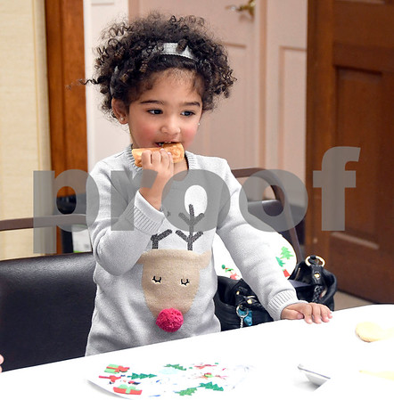 12/9/2017 Mike Orazzi | Staff Rylee Claxton,2, eats a cookie during the Snowman Party held at the New Britain Youth Museum at Hungerford Park Saturday afternoon.