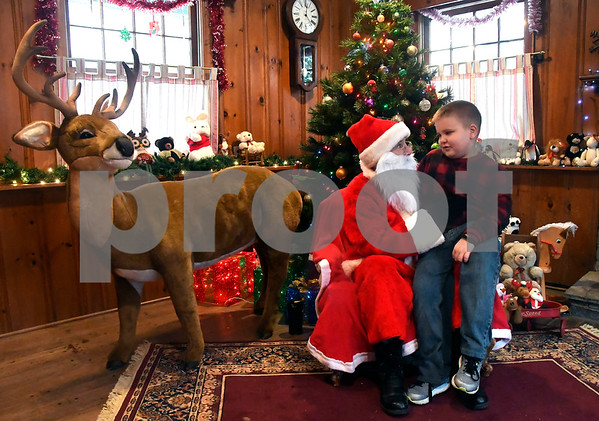 12/10/2017 Mike Orazzi | Staff Gene Daily,8, meets with Santa at the Pebble House during the Annual Santas Farm Workshop held at Indian Rock Nature Preserve in Bristol Saturday morning.