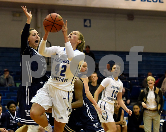 12/9/2017 Mike Orazzi | Staff CCSU's Morgan Johnson (42) and Yale University's Jen Berkowitz (12) during women's hoops in New Britain.