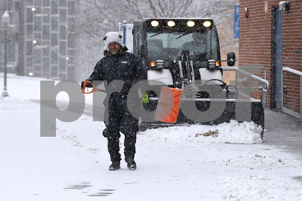 12/9/2017 Mike Orazzi | Staff Roberto Gonzalez while clearing snow on the campus of Central Connecticut State University during Saturday's snowstorm.