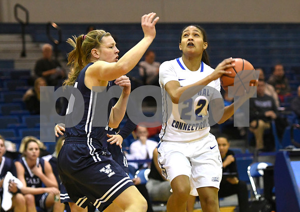 12/9/2017 Mike Orazzi | Staff CCSU's Ashley Chin (22) and Yale University's Alex Cade (15) during women's hoops in New Britain.