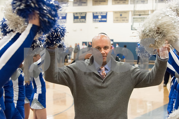 02/12/18 Wesley Bunnell | Staff Bristol Eastern boys basketball defeated visiting Plainville 45-33 on Tuesday night at Bristol Eastern High School. Head coach Bunty Ray walks off the court between cheering Bristol Eastern Cheerleaders.