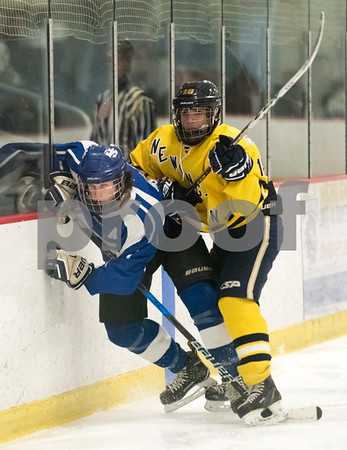 02/14/18 Wesley Bunnell | Staff Hall-Southington hockey vs Newington-Berlin on Wednesday night at Newington Arena. Newington's Nick Deriu (18) against the boards with a Southington skater.