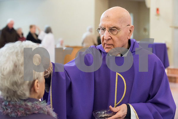 02/14/18 Wesley Bunnell | Staff Parishioners of St. Ann Church in Bristol attended afternoon mass on Ash Wednesday. Father Robert Russo gives out ashes to a parishioner.