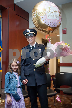 02/15/18 Wesley Bunnell | Staff The New Britain Police Department promoted three of its own including the first female captain in its history. Newly promoted Captain Jeanette Portalatin stands with her daughter Mike, age 6, after the ceremony.