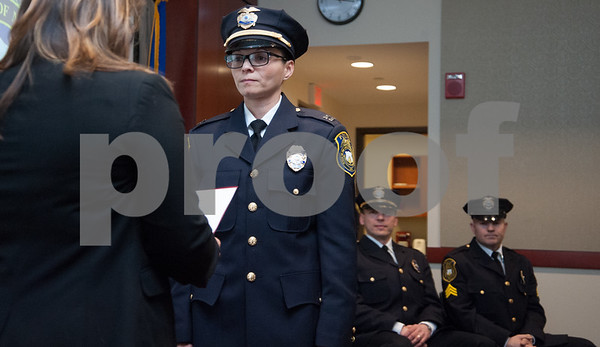 02/15/18 Wesley Bunnell | Staff The New Britain Police Department promoted three of its own including the first female captain in its history. Jeanette Portalatin is sworn in as captain by Mayor Erin Stewart.