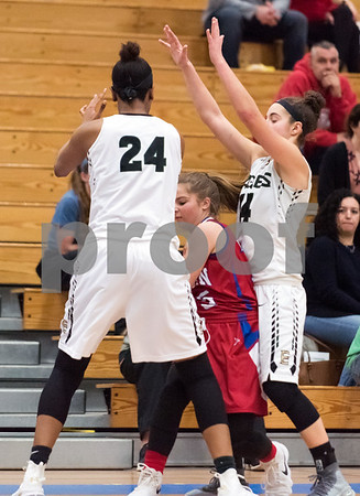 02/20/18 Wesley Bunnell | Staff Berlin girls basketball was defeated 80-50 by Enfield at Glastonbury High School on Tuesday night during the CCC tournament. Carly Grega (15) is double teamed by Mary Baskerville and Caterina Fonseca (14).