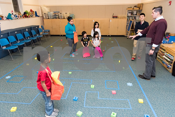 02/26/18 Wesley Bunnell | Staff Div'enchii, age 7, waits his turn as the title character Pac-Man in the 1980's video game in a life size version at the Bristol Public Library on Monday night. Waiting as ghosts are Jabreea, age 11, Kevin, age 4, Jackie , age 6 and Kayla, age 8. The video game was organized by Childrens and Teen Librarian Mr. Jose , front R, and volunteer Richard Tian, back right.