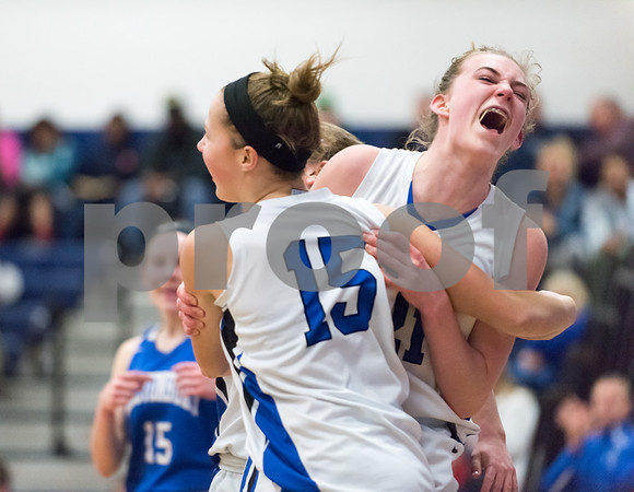 02/26/18 Wesley Bunnell | Staff Southington girls basketball fell 61-54 to visiting Glastonbury in the first round of the LL state tournament. Allison Carr (15) is congratulated by swarmed by teammates after a basket which drew a foul.