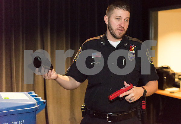 02/27/18 Wesley Bunnell | Staff Ofc. Joe Blansfield from the New Britain Police Department Training Division holds a holster and training pistol which is designed for special use with the department's indoor MILO Range to help train officers in using firearms in various simulated scenarios.