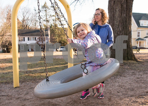 02/27/18 Wesley Bunnell | Staff Three year old Adelaide Tynik smiles as she is pushed on a swing at Federal Hill Park on Tuesday afternoon by her mother Daisha Haines.