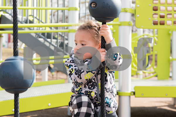02/21/18 Wesley Bunnell | Staff Jaxsen, age 2, plays in a warm Walnut Hill Park playground on Wednesday morning during a visit by the New Britain YMCA Childcare Academy at 111 Hart St.