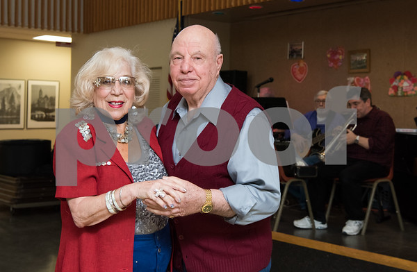 02/21/18 Wesley Bunnell | Staff Peg Mottola, L, and Evo Rondini dance to live music at the New Britain Senior Center on Wednesday afternoon.