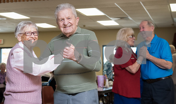 02/21/18 Wesley Bunnell | Staff Winifred Hutchins dances with Joseph Smyk to a live band at the New Britain Senior Center on Wednesday afternoon. Joseph turns 97 in approximately 2 weeks.