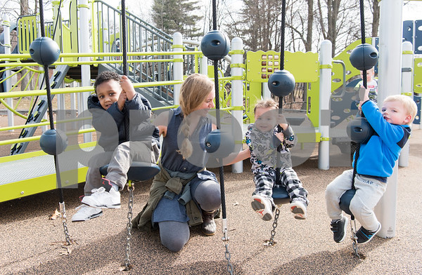 02/21/18 Wesley Bunnell | Staff Teacher Melissa Bengston watches toddlers from the New Britain YMCA Childcare Academy at 111 Hart St as they enjoy a warm Wednesday morning playing at Walnut Hill Park including two year olds Mason, L, Jaxsen, and Rowen.