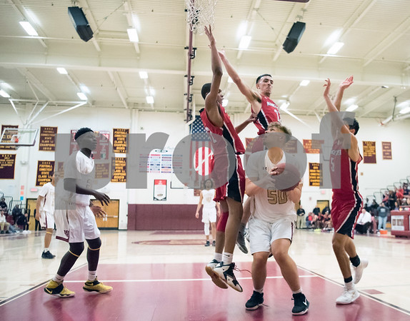 02/22/18 Wesley Bunnell | Staff New Britain boys basketball defeated Manchester 60-52 on Thursday night at New Britain High School. Daniel Kownacki (5) stops as he lets the defenders jump past him before taking his shot.