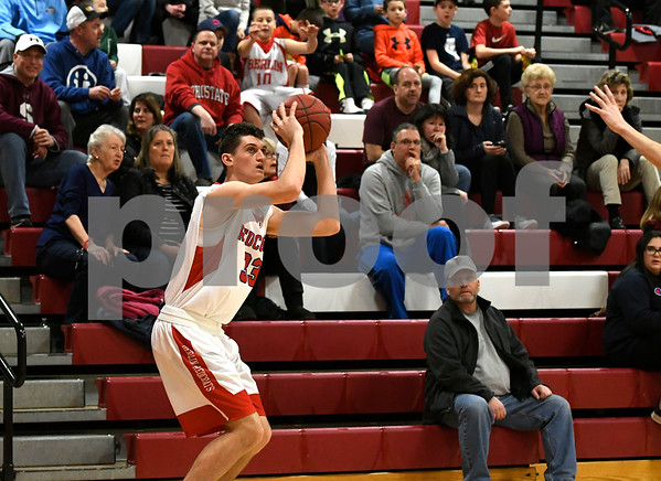 2/3/2018 Mike Orazzi | Staff Berlin High School's Mike McCarthy (33) during Saturday's boys game with Farmington in Berlin.