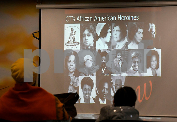 2/3/2018 Mike Orazzi | Staff Lena Harwood Pacheco, Director of Education at the Connecticut Women's Hall of Fame, during a presentation on Connecticut's African American Heroines at the New Britain Public Library Saturday.