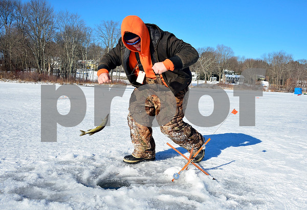 2/3/2018 MIke Orazzi | Staff Jacob Wassik pulls in a pickerel during the Terryville Fish & Game Club's annual ice fishing derby held on Middle Pond Saturday in Terryville.