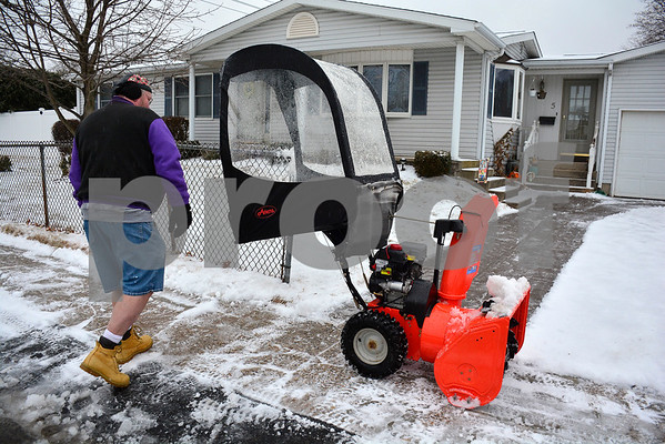 2/7/2018 Mike Orazzi   Staff Jerry (didn't want to give his last name) while clearing snow while dressed in shorts along West Gate Street in Bristol during Wednesday's storm.