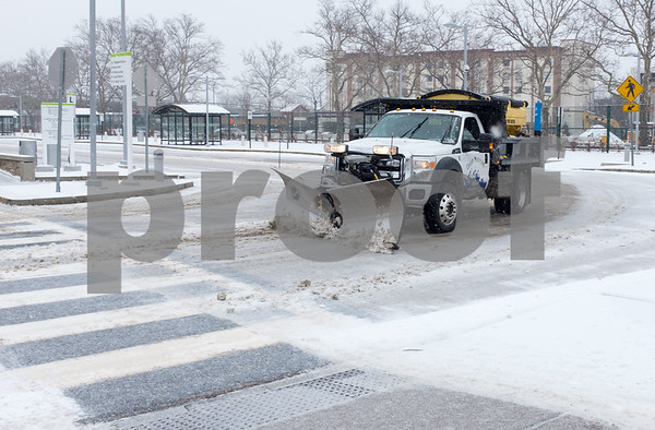 02/07/18 Wesley Bunnell   Staff Snow crews from Cutting Edge Landscaping working Wednesday afternoon to keep the downtown New Britain CTfastrak Station clear from snow.