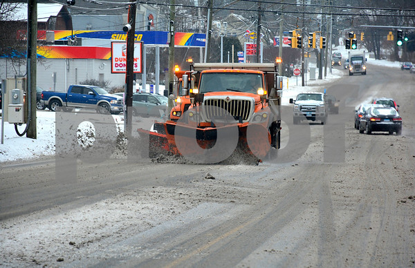 2/7/2018 Mike Orazzi   Staff A couple of state DOT plows on Route 6 during Wednesday's storm in Bristol near King Street.