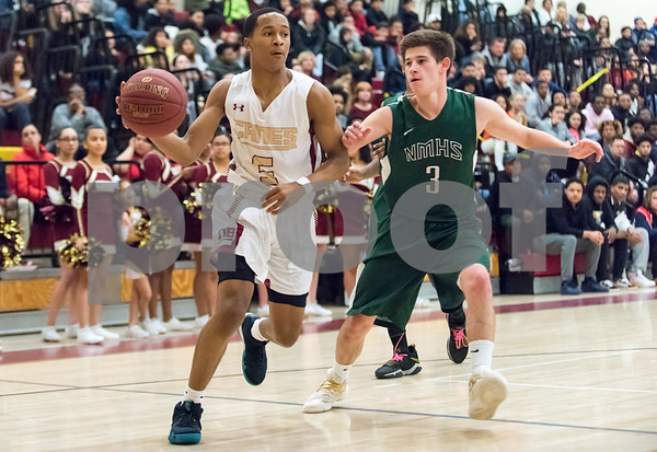 03/06/18 Wesley Bunnell | Staff New Britain basketball defeated New Milford in the first round of the state tournament on Tuesday evening at New Britain High School. Thameen Dupree (5).