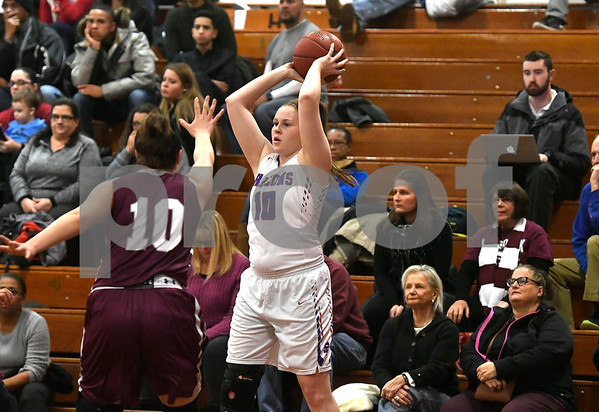 1/3/2017 Mike Orazzi | Staff St. Paul's Molly Hooks (10) and Naugatuck's Alyssa Peterson (10) during Wednesday night's girls basketball game in Bristol.