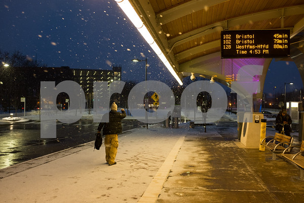 01/08/18 Wesley Bunnell | Staff A light snowstorm came through New Britain including the downtown Fastrak station on Monday evening.