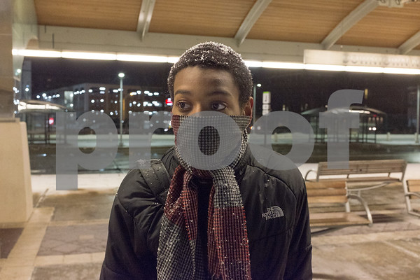 01/08/18 Wesley Bunnell | Staff A light snowstorm came through New Britain including the downtown Fastrak station on Monday evening. Itachi Makavili is bundled up as the light snow falls on top of his head.
