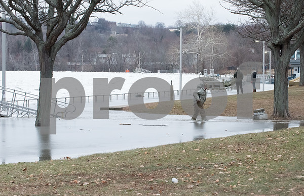 01/15/18 Wesley Bunnell | Staff Large amounts of ice make their way down the Connecticut River in Middletown flooding parts of Harbor Yard just past the Arrigoni Bridge. Water has flooded around the entrance to Lady Katharine Cruises as a man walks towards the parking lot with water almost up to the top of his boots.