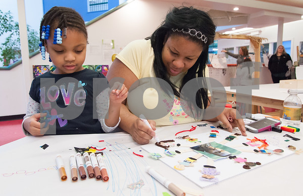 01/15/18 Wesley Bunnell | Staff Imagine Nation held special programs on Monday in honor of Martin Luther King Jr including making peaceful signs, banners and readings on MLK. Chance Simmons, age 5, and mom Charice Gaines complete their signs honoring Dr. King.