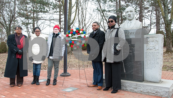 01/15/18 Wesley Bunnell | Staff The City of New Britain commemorated the life of Martin Luther King Jr. with a ceremony Monday morning at Trinity-on-Main followed by a wreath laying service at the Dr. Martin Luther King Jr. Park at noon. The events were sponsored by Mayor Erin E. Stewart and the New Britain Commission on Human Rights and Opportunities. New Britain Student Ambassadors Sara Collins, 2nd from L, and Kelley Crittenden along stand along with Community Leader Mr. Jerrell Hargraves and Commissioner Jessica Angelo-Julien from the Commission on Human Rights and Opportunities and Common Council Liaisons.