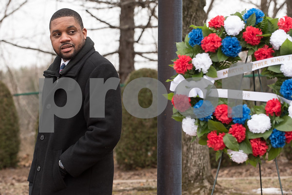 01/15/18 Wesley Bunnell | Staff The City of New Britain commemorated the life of Martin Luther King Jr. with a ceremony Monday morning at Trinity-on-Main followed by a wreath laying service at the Dr. Martin Luther King Jr. Park at noon. The events were sponsored by Mayor Erin E. Stewart and the New Britain Commission on Human Rights and Opportunities. Community Leader Mr. Jerrell Hargraves who gave the keynote address glances back over his shoulder at the wreath and monument to Dr. King at the conclusion of the ceremony.