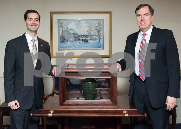 01/16/18 Wesley Bunnell | Staff Michael Farrell , Vice President, Licensed Funeral Director and Embalmer stands with his father Bill Farrell Jr, Owner, President, Licensed Funeral Director and Embalmer next to a four person funeral bier at Farrell Funeral Home.