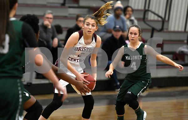 1/16/2018 Mike Orazzi | Staff Bristol Central Girls Basketball's Allison Jessie (2) and Maloney's Jaylynn Muniz (4) during Tuesday night's game in Bristol.