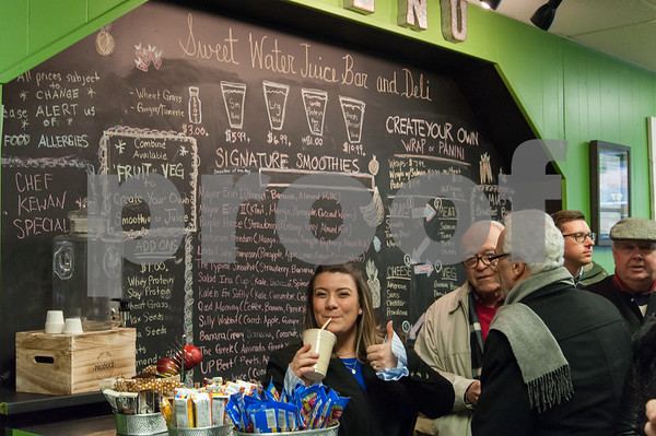 01/16/18 Wesley Bunnell | Staff The official ribbon cutting for Sweetwater Juice Bar & Deli located at 60 West Main St. was held on Tuesday afternoon. Mayor Erin Stewart gives the thumbs up while enjoying her smoothie.