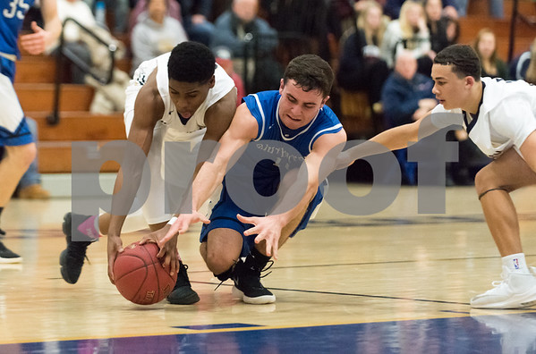 01/16/18 Wesley Bunnell | Staff Newington High boys basketball was defeated at home by Soutington on Tuesday evening 52-44. Louis Egbuna (10) and Cameron Clynes (10) fight for the ball.