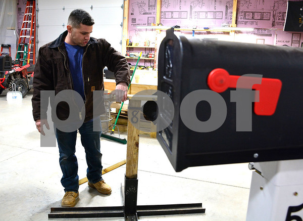 1/16/2018 Mike Orazzi | Staff Gary Celella Jr. swings at a special type of mailbox he invented which is intended to not break if hit by snowplows.