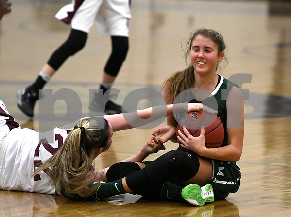 1/16/2018 Mike Orazzi | Staff Bristol Central Girls Basketball's Sarah Guerin (22) and Maloney's Alexa Papallo (15) during Tuesday night's game in Bristol.