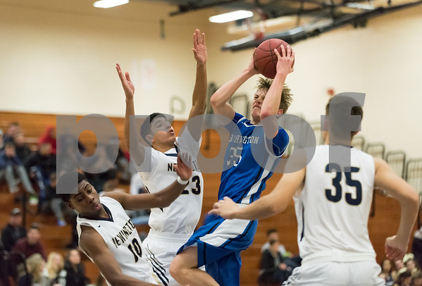 01/16/18 Wesley Bunnell | Staff Newington High boys basketball was defeated at home by Soutington on Tuesday evening 52-44. Andrew Lohneiss (35).