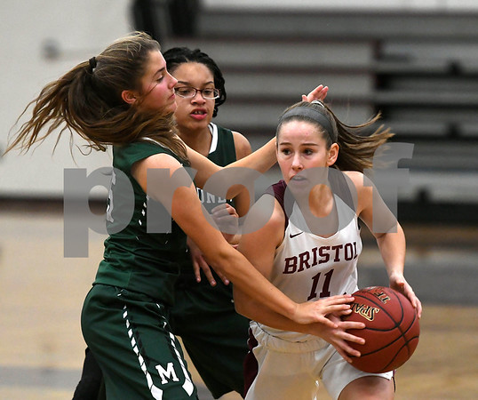 1/16/2018 Mike Orazzi | Staff Bristol Central Girls Basketball's Ashley Macdonald (11) and Maloney's Alexa Papallo (15) and Dasia White (21) during Tuesday night's game in Bristol.