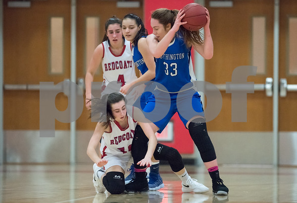 01/22/18 Wesley Bunnell | Staff Southington vs Berlin girls basketball at Berlin High School on Monday evening. Janette Wadolowski (33) fights for a loose ball.