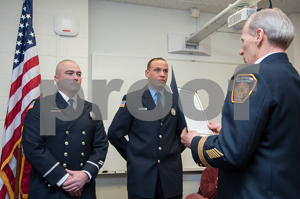 01/22/18 Wesley Bunnell | Staff The Bristol Fire Department honored two of their own on Monday evening for helping save the life of an elderly woman. Lt. Lance Lavore, L, and FF Adam Hayes are shown standing as Deputy Chief John Ziogas reads their citations during the fire commission meeting at city hall.