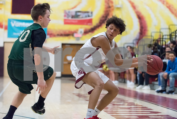 01/23/18 Wesley Bunnell | Staff New Britain boys basketball vs Enfield on Tuesday evening at New Britain High School. Jamani Eaton (4).