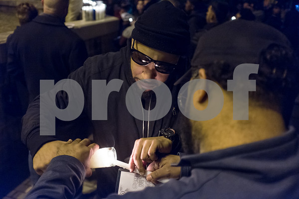01/26/18 Wesley Bunnell   Staff A candle light vigil was held for 18 year old Moses Negron on Friday evening outside of New Britain High School Satellite Careers Academy where Negron was a student. Negron was one of three killed in a rollover crash on I91 at 7:30am last Sunday morning. Moses Negron lights a candle for his son, Moses, with the help of his brother Joshua Nieves.